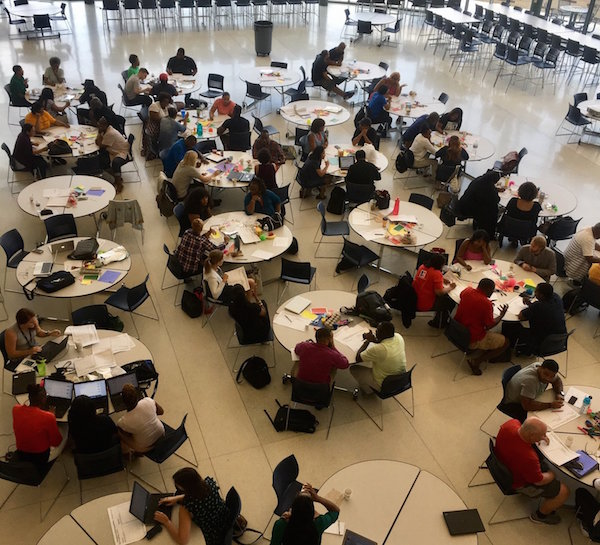 DCPS educators in the Ballou HS cafeteria participate in a design thinking workshop.